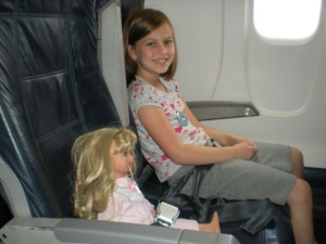 grey and her doll on the plane